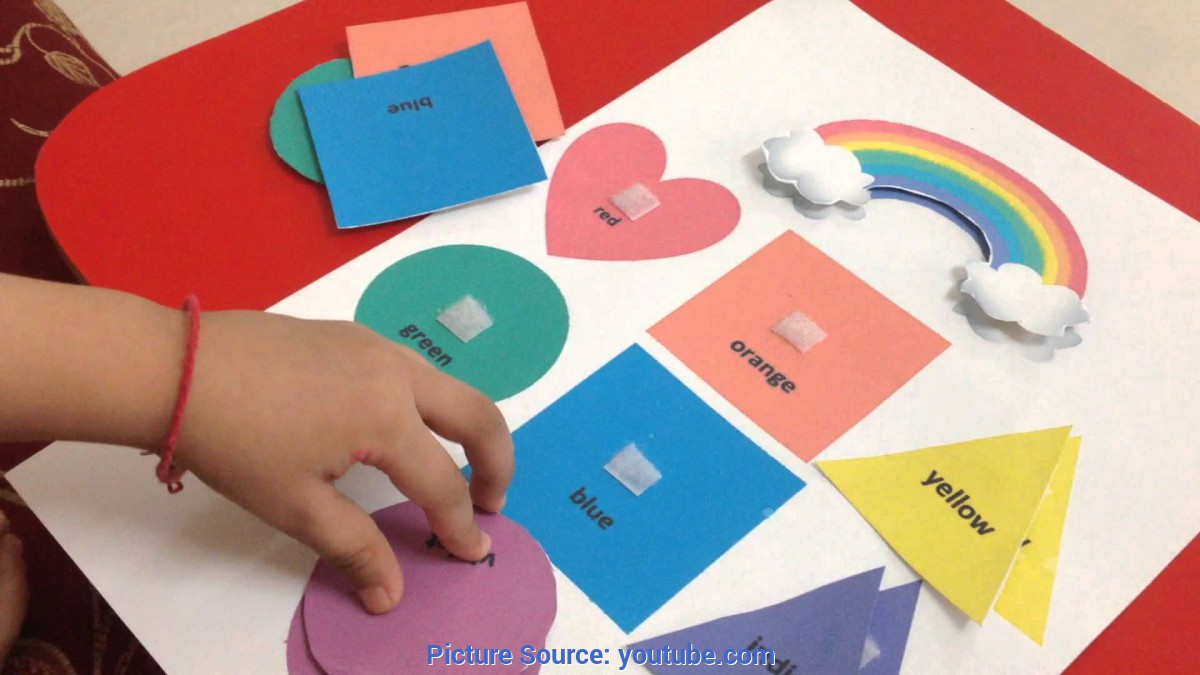 Great Preschool Activities For Kids Toddler Doing A Rainbow-Themed Color & Shape Matching Activit